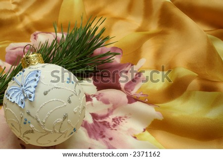 Pine and christmas ball on Silk - stock photo