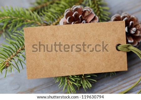 Pine branch with label on wooden background