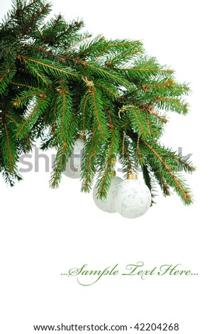 Pine branches and christmas balls isolated on white background - stock photo
