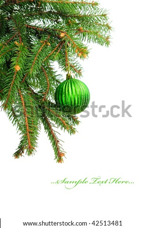 Pine branches and green christmas ball isolated on white background - stock photo