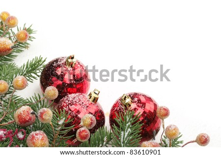Pine branches, berries and balls with snow for Christmas border. - stock photo