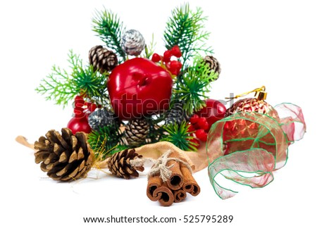 Pine branches with cones, Christmas ball, viburnum berries, cinnamon sticks and ribbon on a white background. Christmas decoration.