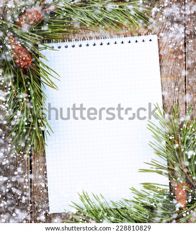 Pine branches with cones on old wooden background - stock photo