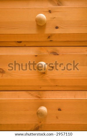 Pine chest of drawers - stock photo