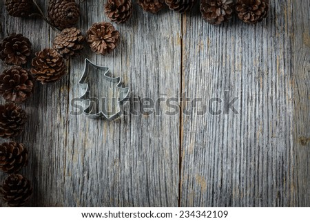 Pine Cones and Christmas Tree on a Rustic Wood Background - stock photo