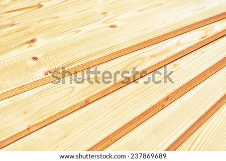 Pine planks stacked and ready for some carpentry job or wood works. Close up with selective focus and shallow depth of field. - stock photo