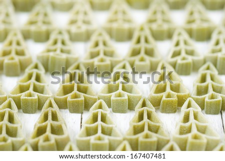 pine tree shape uncooked pasta on white wood table