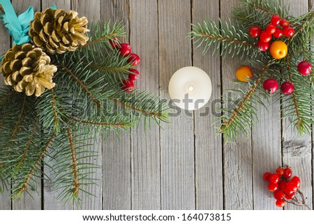 pine twig christmas decoration on rustic wood table background - stock photo