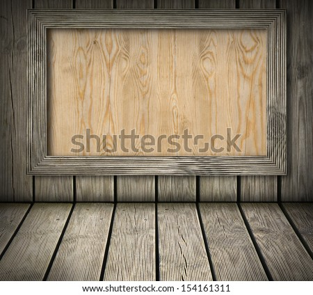 Pine wood board on wooden wall background