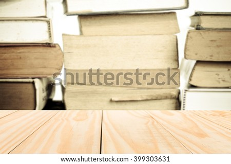 Pine wood table on blur stack old book background. can be used for display or montage your products - stock photo