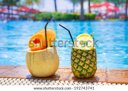 Pineapple and melon cocktails at the swimming pool - stock photo