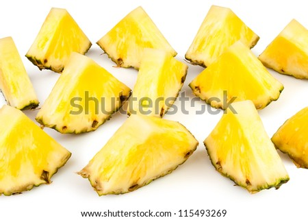 pineapple chunks on white background - stock photo