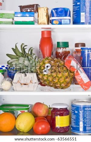 pineapple in fridge - stock photo