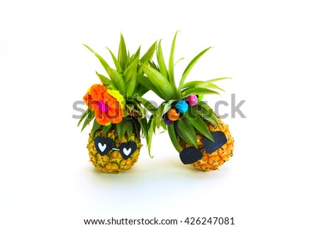 pineapple in sunglasses on a white background.