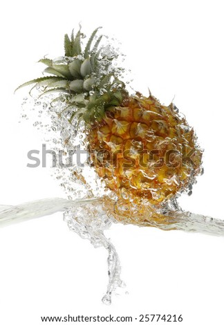 Pineapple in the water, on the tide - stock photo