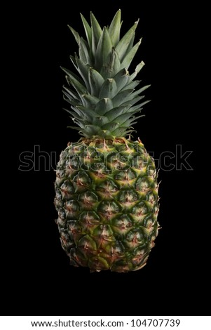 Pineapple isolated on black - stock photo