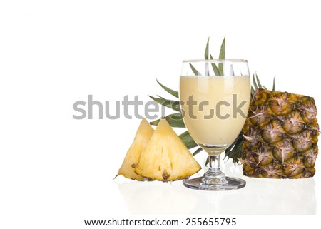 Pineapple juice and pineapple slice isolated on white background.