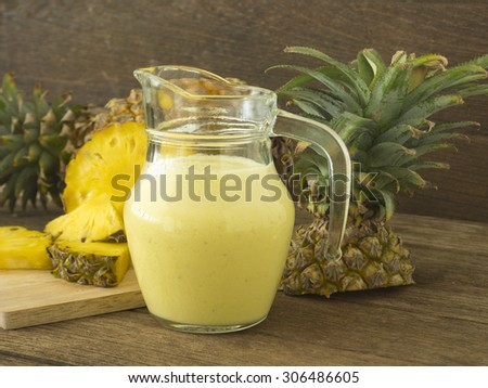 pineapple juice and pineapple slice on wood table. for health. - stock photo