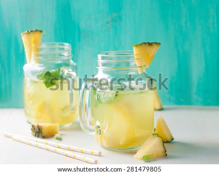 Pineapple lemonade with lemon and mint, selective focus