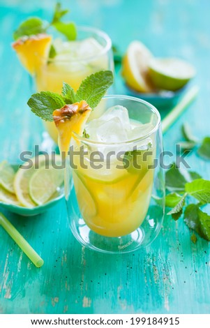Pineapple lemonade with lemon,lime and mint - stock photo