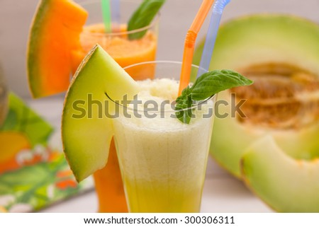 Pineapple melon with fresh fruit and mint leaves - stock photo