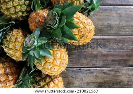 Pineapple on wooden grunge background - stock photo