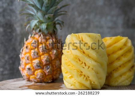 Pineapple, peeled pineapple on a wooden background - stock photo