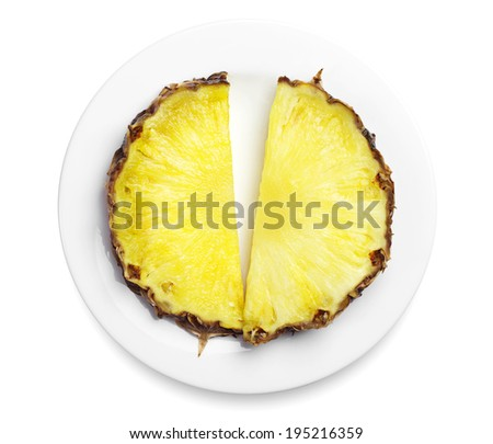 Pineapple slices in a plate on white background - stock photo