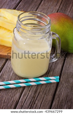 Pineapple smoothie with pineapple slices and mango