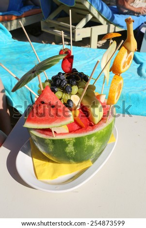 Pineapple with cocktail and pink umbrella - stock photo