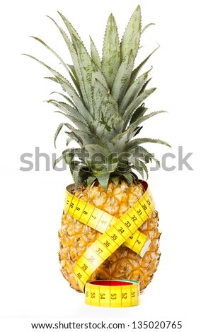 Pineapple with measuring tape isolated on white
