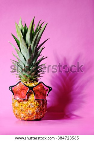 pineapple with sunglasses - stock photo