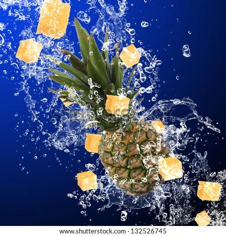 Pineapple with water splash - stock photo
