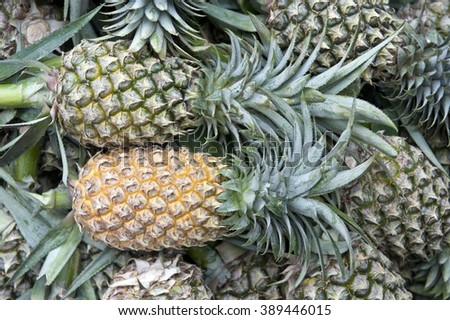Pineapples - asian marketplace - stock photo