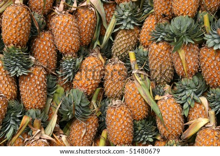 pineapples in a market place - stock photo