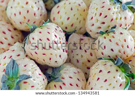 Pineberries close-up, selective focus (aka pineapple strawberries or white strawb.) The pineberry is a strawberry cultivar originating from a South American species. Faced extinction risk until 2003 - stock photo