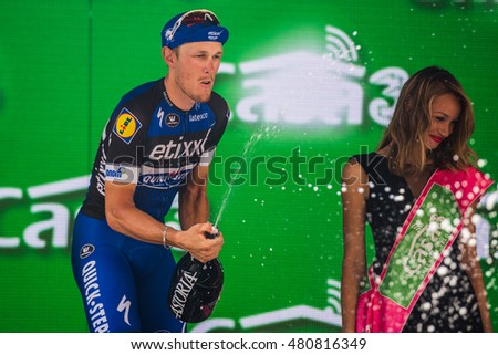 Pinerolo, Italy May 26, 2016; Matteo Trentin on the podium after winning the stage defeating Moreno Moser and Giunluca Brambilla in Pinerolo.