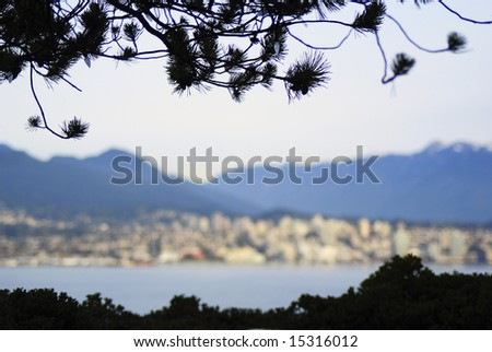Pinetree frame with blurred north Vancouver from Canada place - stock photo