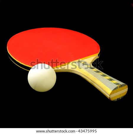 Ping pong or table tennis paddle and ball over black - stock photo