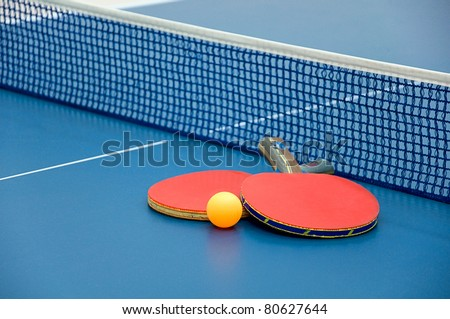 Ping pong paddles and ball - stock photo
