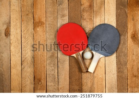 Ping pong paddles and ball on vintage background - stock photo