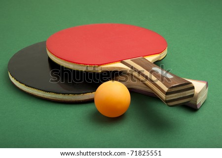 Ping pong paddles and balls - stock photo