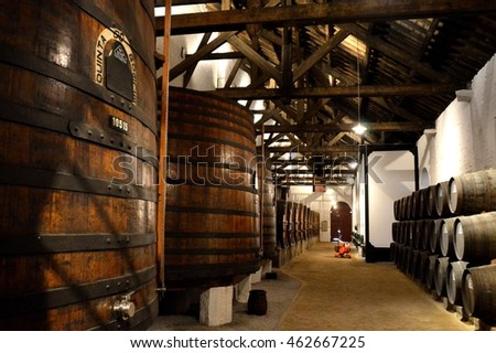 PINHAO, PORTUGAL - JUNE 20, 2016: Vinery and rows of barrels with aging port wine
