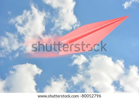 pink air flying in blue sky - stock photo