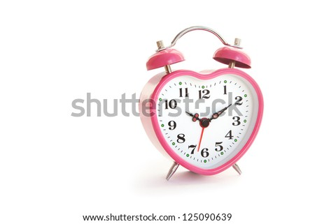 pink alarm clock in the form of heart isolated on white background cut out