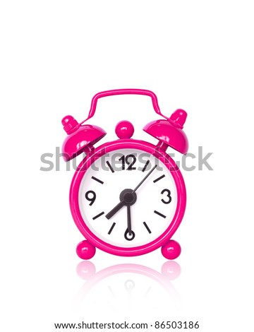 Pink alarm clock on white background with copy space - stock photo