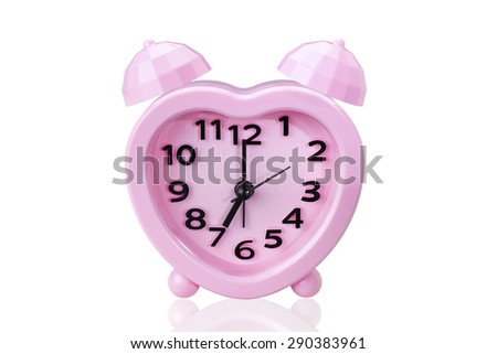 pink alarm clock on white isolated background with clipping path. - stock photo