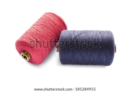 Pink and black cotton bobbins isolated over white