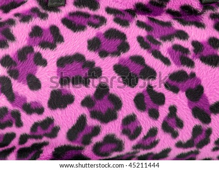 Pink and black faux fur leopard print backgound