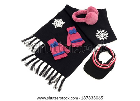 Pink and black winter accessories isolated on white background. Black wool scarf with  matching pink gloves,a visor hat and earmuffs. - stock photo